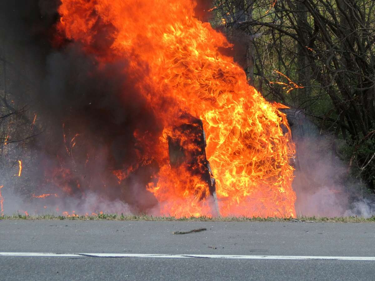 A car burst into flames Saturday after rolling and crashing into a ditch along Route 32 in Bethlehem. (Tom Heffernan Sr. / Special to the Times Union)