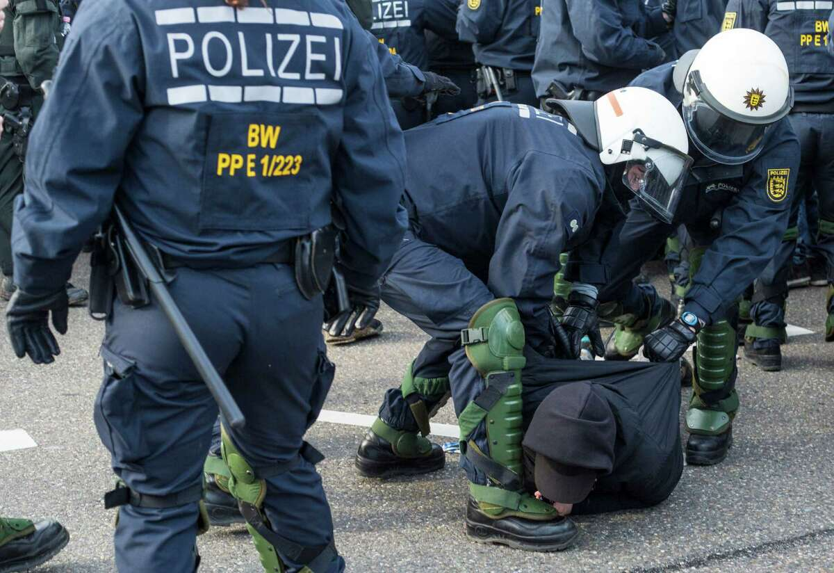 Police detain a leftist demonstrator on the occasion of a party convention of the Alternative for Germany, or AfD, in Stuttgart, Germany Saturday, April 30, 2016. (Christoph Schmidt/dpa via AP) ORG XMIT: LGL104