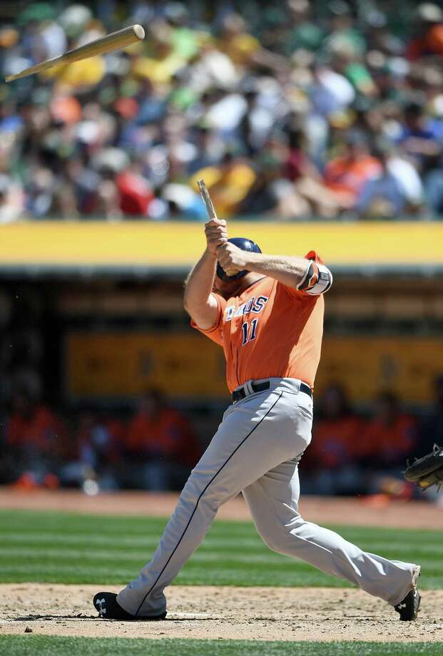 Evan Gattis shatters his bat on a fifth-inning groundout Saturday. With the bases loaded in the ninth, Gattis would hit into a game-ending 6-4-3 double play. Photo: Thearon W. Henderson, Stringer / 2016 Getty Images