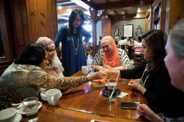 From left, Afshan Jilani and Safra Khan celebrate the birthday of Fatima Sultan, standing, along with Bibi Khan,  Saira Jilani and Lily Nasar during their regular Friday lunch meeting in Houston.