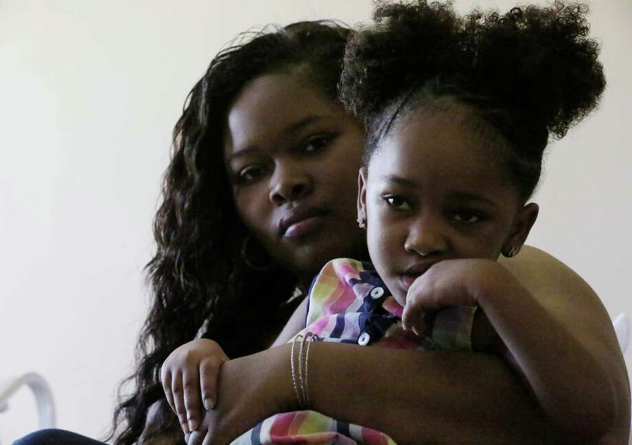 Courissa Hall visits the rehabilitation hospital treating her 4-year-old daughter, Nevaeh, who suffered brain damage during an appointment at a dental clinic. She is seeking criminal charges against the dentist. Photo: Jon Shapley, Staff / © 2015  Houston Chronicle