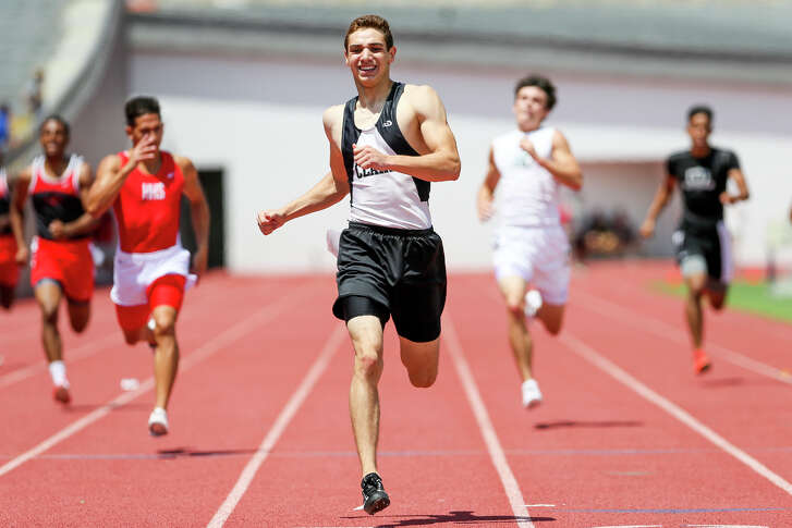 Clark's Jon Maas (center) nears the finish line of the 6A boys 400-meter dash during the finals of the Region IV championships. Maas' time of 47.26 seconds broke his record of 47.73.
