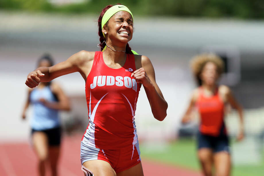 Judson's Mariah Kuykendoll reacts after winning the 6A girls 400-meter dash during the finals of the Region IV-6A/5A track and field championships at Alamo Stadium on April 20, 2016. Kuykendoll set a new regional record in the event with a time of 54.63 seconds. Photo: Marvin Pfeiffer /San Antonio Express-News / Express-News 2016