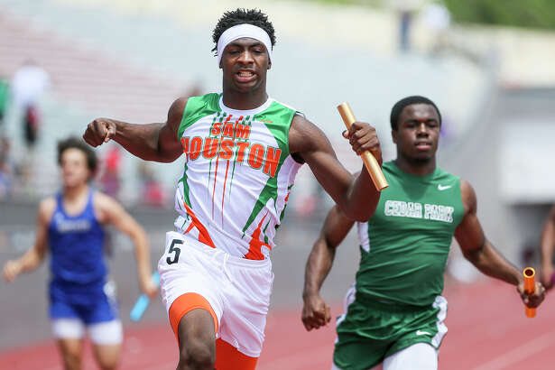 Sam Houston's Jonathan Challenger reacts after crossing the finish line of the 5A boys 400-meter relay during the Region IV-6A/5A track finals.