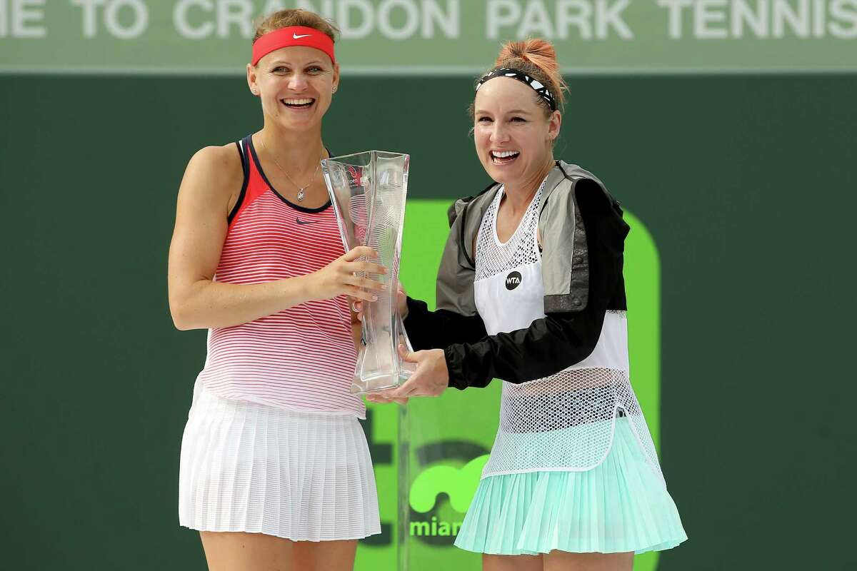 KEY BISCAYNE, FL - APRIL 03: Lucie Safarova of Czech Republic and Bethanie Mattek-Sands pose with the Butch Buchholz trophy after defeating Timea Babos of Hungary and Yaroslava Shvedova of Kazakhstan during the doubles final on Day 14 of the Miami Open presented by Itau at Crandon Park Tennis Center on April 3, 2016 in Key Biscayne, Florida. (Photo by Matthew Stockman/Getty Images) ORG XMIT: 600143299