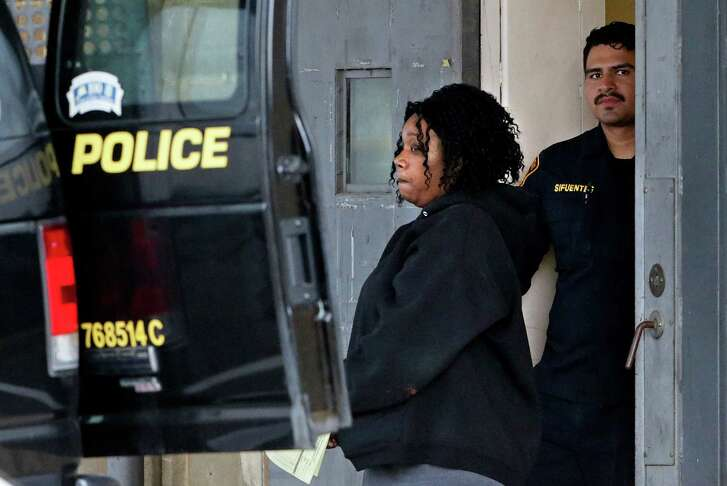 Porucha Phillips is taken from the magistrate's office in an San Antonio Police Department transport vehicle just after 6 p.m. on April 29, 2016. Phillips was charged with a third-degree felony count of injury to a child by omission resulting in bodily injury and another resulting in serious bodily injury, a first-degree felony.