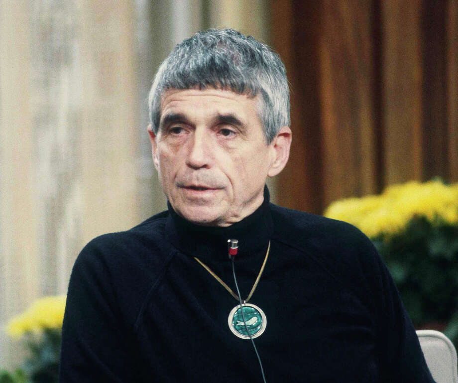 """File-This Feb. 16, 1981, file photo shows Daniel Berrigan, ex-priest, now political activist on NBC-TV's """"Today"""" show in New York. The Roman Catholic priest and Vietnam war protester, Berrigan has died. He was 94. Michael Benigno, a spokesman for the Jesuits USA Northeast Province, says Berrigan died Saturday, April 30, 2016, at a Jesuit infirmary at Fordham University.  (AP Photo/Dave Pickoff, File) Photo: Dave Pickoff, STF / AP"""
