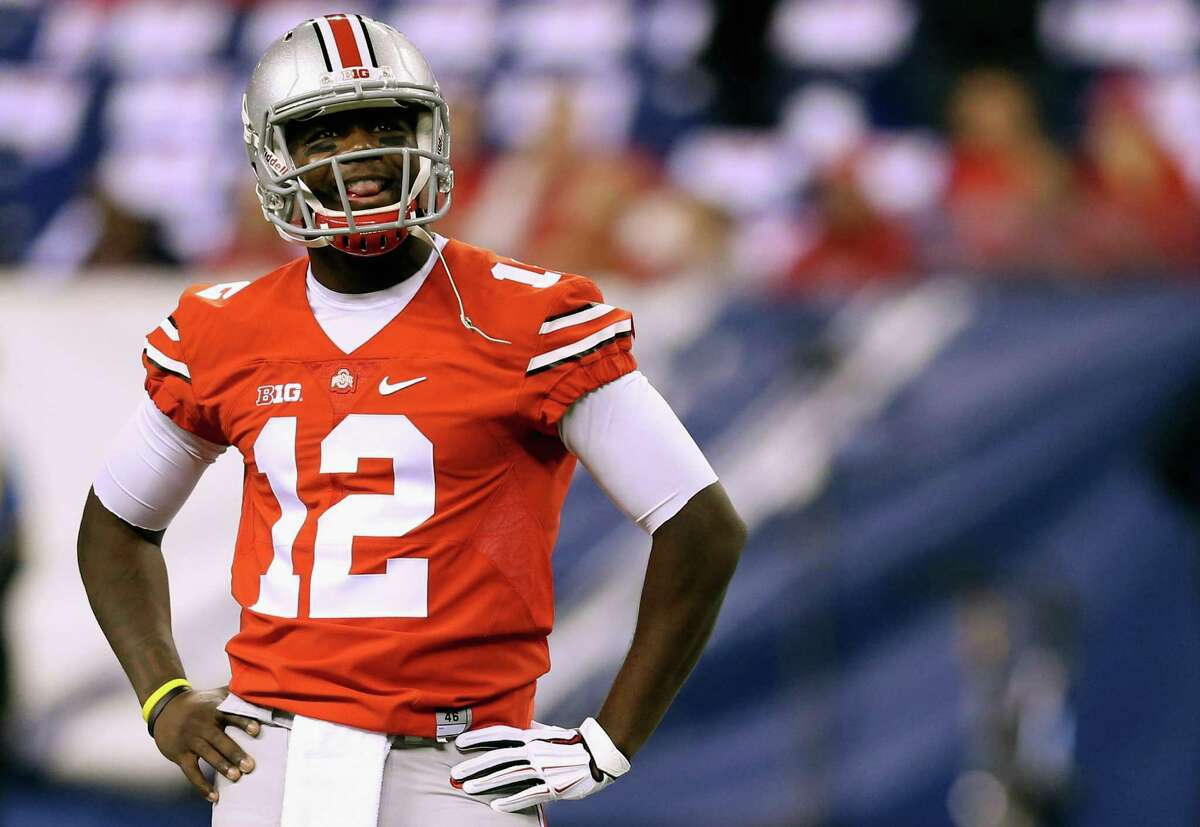 INDIANAPOLIS, IN - DECEMBER 06: Quarterback Cardale Jones #12 of the Ohio State Buckeyes smiles on the field during warm ups before playing against the Wisconsin Badgers in the Big Ten Championship at Lucas Oil Stadium on December 6, 2014 in Indianapolis, Indiana. (Photo by Andy Lyons/Getty Images) ORG XMIT: 522482151