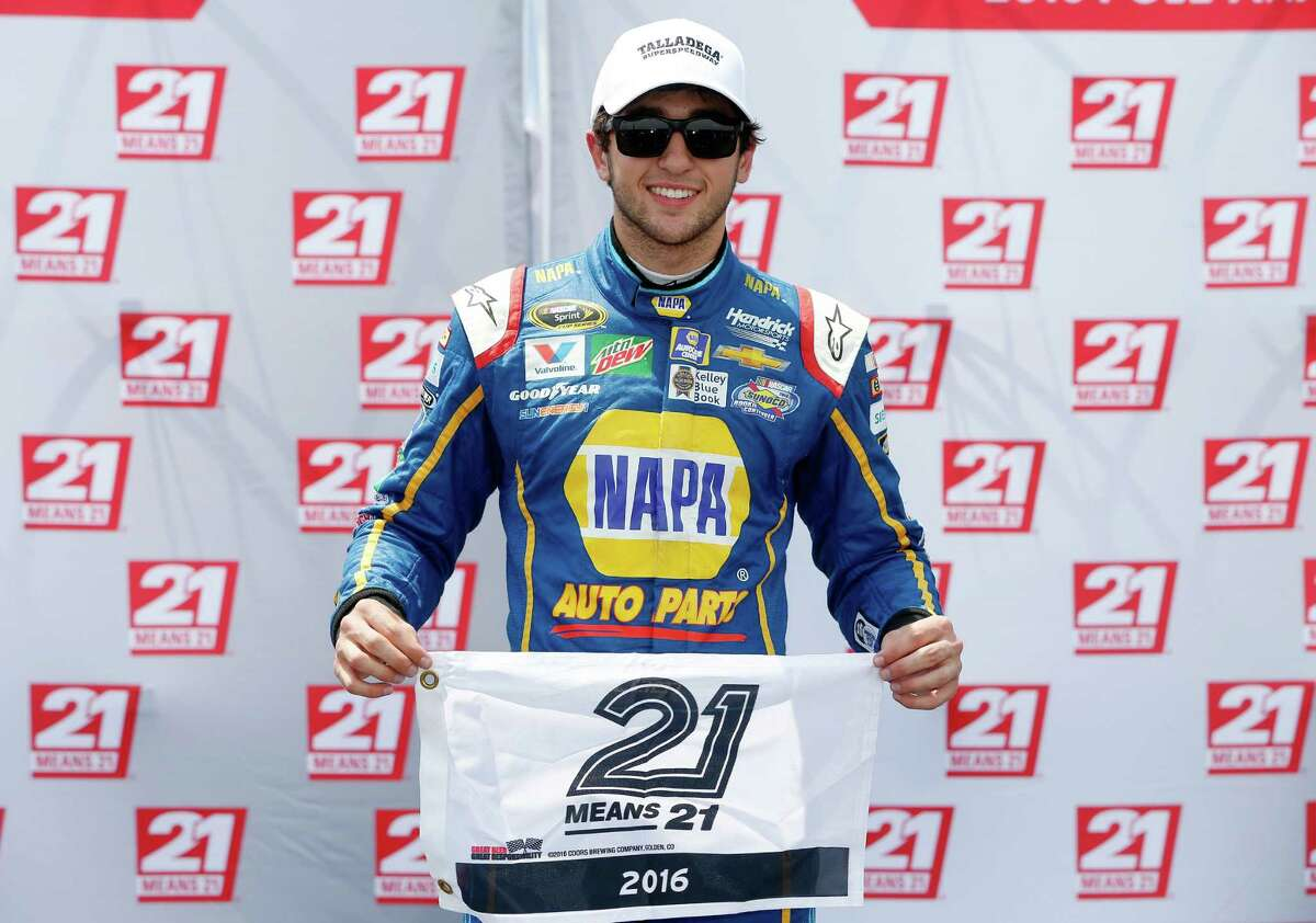 TALLADEGA, AL - APRIL 30: Chase Elliott, driver of the #24 NAPA Auto Parts Chevrolet, celebrates with the 21 Means 21 pole award after qualifying for pole position for the NASCAR Sprint Cup Series GEICO 500 at Talladega Superspeedway on April 30, 2016 in Talladega, Alabama. (Photo by Brian Lawdermilk/Getty Images) ORG XMIT: 634794071