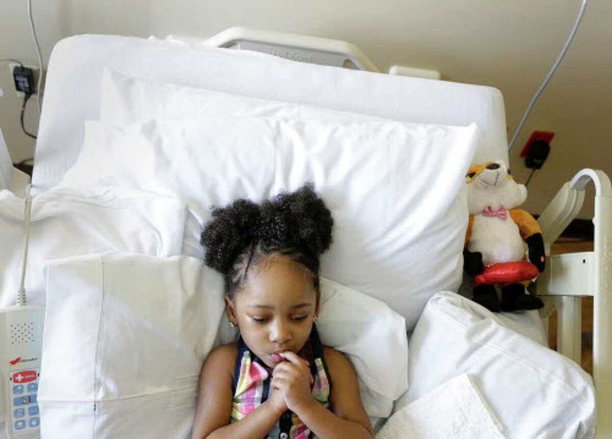 Neveah Hall, 4, is seen in her bed at a specialty and rehabilitation hospital in west Houston Thursday, April 7, 2016, in Houston. She suffered brain damage during a dental procedure.