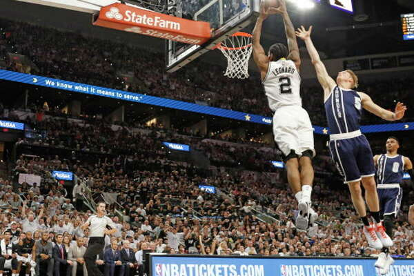 SAN ANTONIO,TX - APRIL 30: Kawhi Leonard #2 of the San Antonio Spurs scores against the Oklahoma Thunder during game one of the Western Conference Semifinals for the 2016 NBA Playoffs at AT&T Center on April 30, 2016 in San Antonio, Texas. NOTE TO USER: User expressly acknowledges and agrees that , by downloading and or using this photograph, User is consenting to the terms and conditions of the Getty Images License Agreement. (Photo by Ronald Cortes/Getty Images)