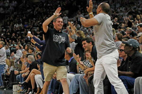 SAN ANTONIO,TX - APRIL 30: San Antonio Spurs fans celebrate a score against the Oklahoma City Thunder during game one of the Western Conference Semifinals for the 2016 NBA Playoffs at AT&T Center on April 30, 2016 in San Antonio, Texas. NOTE TO USER: User expressly acknowledges and agrees that , by downloading and or using this photograph, User is consenting to the terms and conditions of the Getty Images License Agreement. (Photo by Ronald Cortes/Getty Images)