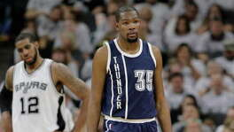 Oklahoma City Thunder forward Kevin Durant (35) walks up court during the first half in Game 1 of a second-round NBA basketball playoff series as San Antonio Spurs forward LaMarcus Aldridge (12) looks on, Saturday, April 30, 2016, in San Antonio. (AP Photo/Eric Gay)   Spurs vs. Thunder NBA playoffs Game 1.