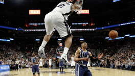 San Antonio Spurs forward Kawhi Leonard (2) scores over Oklahoma City Thunder guard Russell Westbrook (0) during the first half in Game 1 of a second-round NBA basketball playoff series, Saturday, April 30, 2016, in San Antonio. (AP Photo/Eric Gay) 