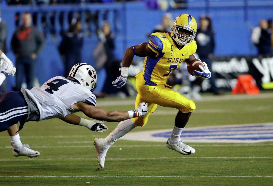 The Texans selected San Jose State's versatile running back Tyler Ervin, right, in the fourth round of the draft to give a much-needed boost to a running game that has often lacked breakaway speed in recent years. Photo: Marcio Jose Sanchez, STF / AP