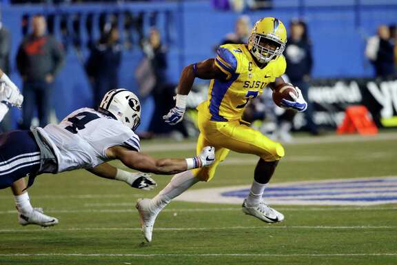 The Texans selected San Jose State's versatile running back Tyler Ervin, right, in the fourth round of the draft to give a much-needed boost to a running game that has often lacked breakaway speed in recent years.