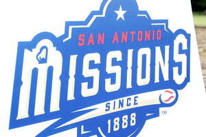 San Antonio baseball gets a new look as representatives from the San Antonio Missions baseball team announce changes in the team's logo and uniforms with the Alamo as a backdrop on November 21, 2014.