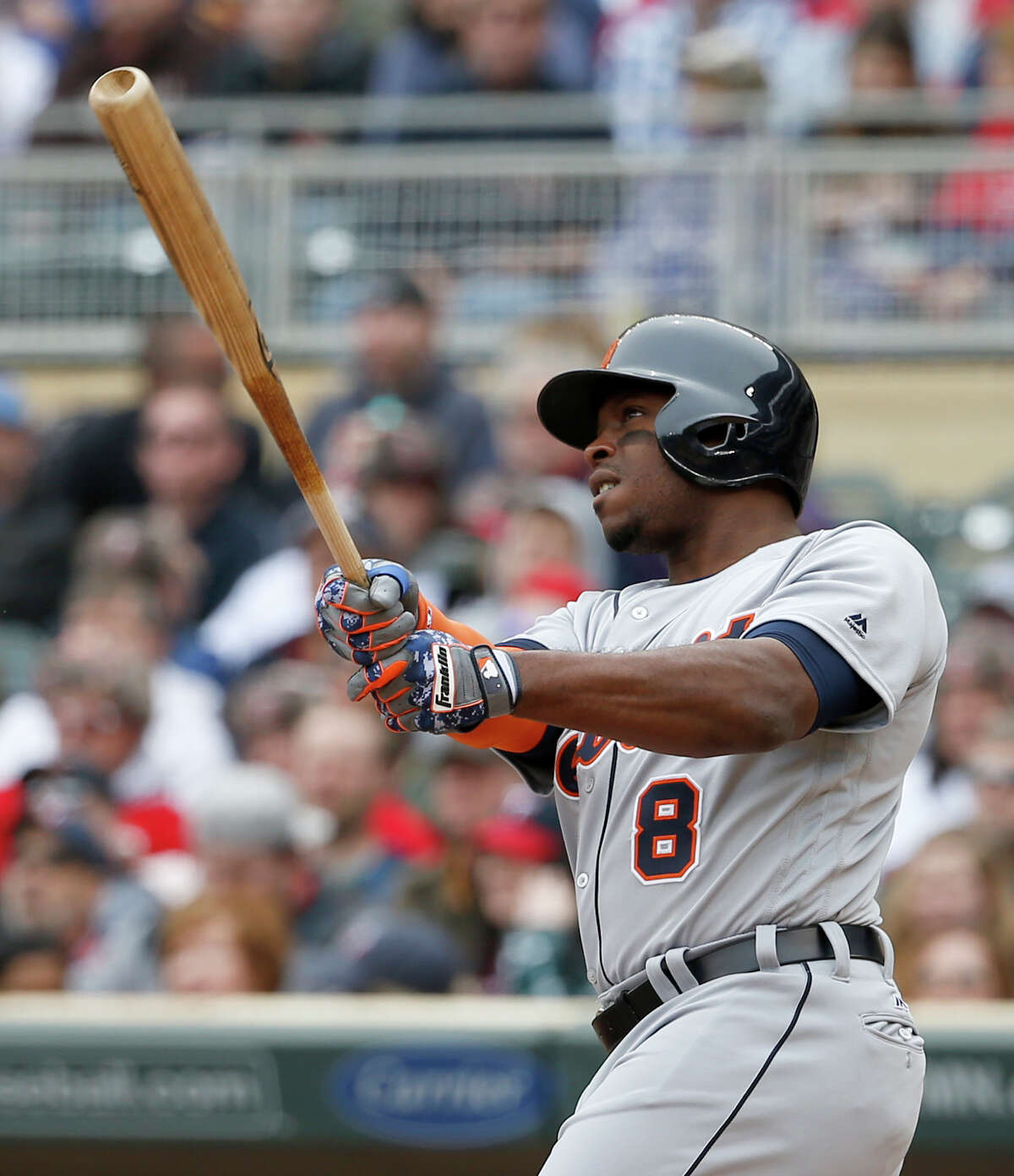 Detroit Tigers' Justin Upton (8) watches the flight of his three-run home run off Minnesota Twins starting pitcher Tyler Duffey during the first inning of a baseball game in Minneapolis, Saturday, April 30, 2016. (AP Photo/Ann Heisenfelt) ORG XMIT: MNAH102