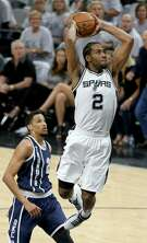 San Antonio Spurs' Kawhi Leonard goes up for a dunk around Oklahoma City Thunder's Andre Roberson during first half action of Game 1 in the Western Conference semifinals Saturday April 30, 2016 at the AT&T Center.