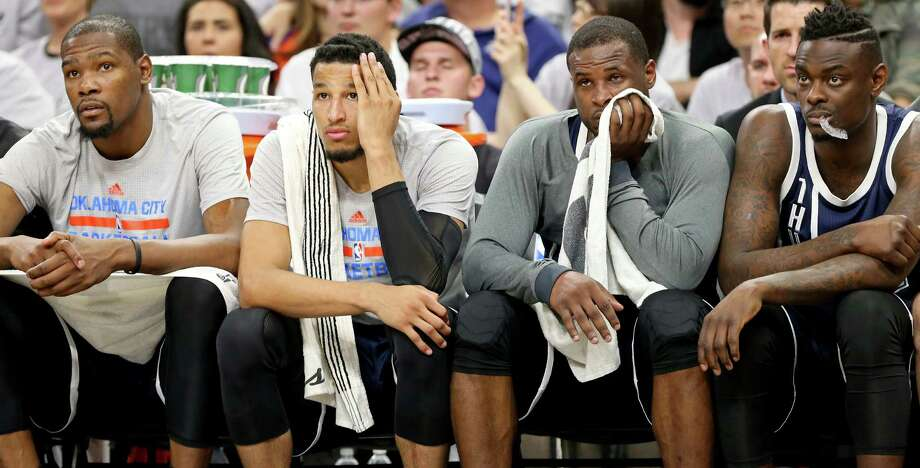 Oklahoma City Thunder's Kevin Durant (from left), Andre Roberson, Dion Waiters, and Anthony Morrow watch  second half action of Game 1 in the Western Conference semifinals against the San Antonio Spurs from the bench Saturday April 30, 2016 at the AT&T Center. The Spurs won 124-92. Photo: Edward A. Ornelas, Staff / San Antonio Express-News / © 2016 San Antonio Express-News