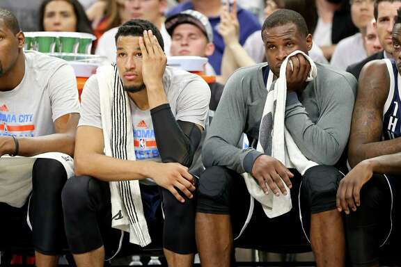 Oklahoma City Thunder's Kevin Durant (from left), Andre Roberson, Dion Waiters, and Anthony Morrow watch  second half action of Game 1 in the Western Conference semifinals against the San Antonio Spurs from the bench Saturday April 30, 2016 at the AT&T Center. The Spurs won 124-92.