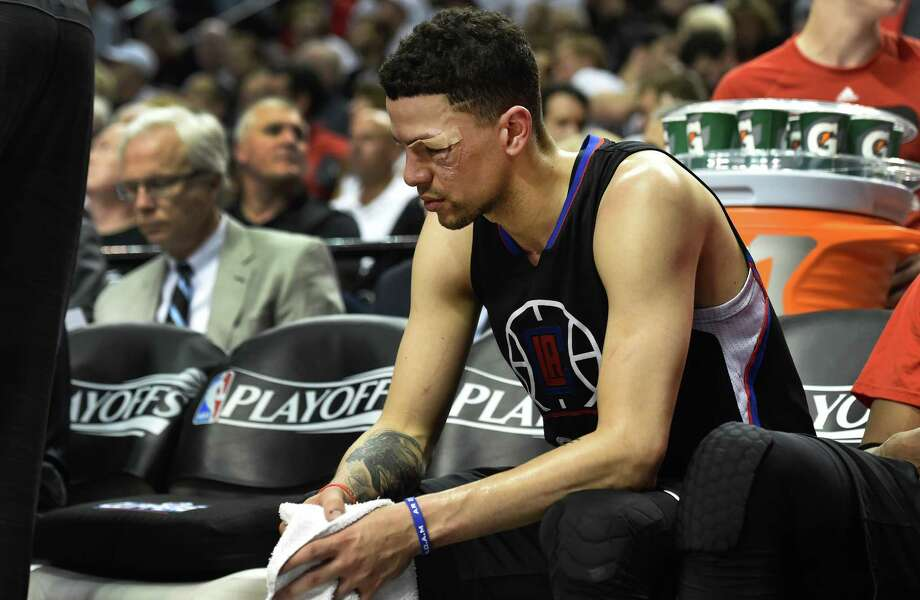 PORTLAND, OR - APRIL 29: Austin Rivers #25 of the Los Angeles Clippers sits on the bench as time runs down in the fourth quarter of Game Six of the Western Conference Quarterfinals against the Portland Trail Blazers during the 2016 NBA Playoffs at the Moda Center on April 29, 2016 in Portland, Oregon. The Blazers won 106-103. NOTE TO USER: User expressly acknowledges and agrees that by downloading and/or using this photograph, user is consenting to the terms and conditions of the Getty Images License Agreement. (Photo by Steve Dykes/Getty Images) Photo: Steve Dykes, Stringer / 2016 Getty Images