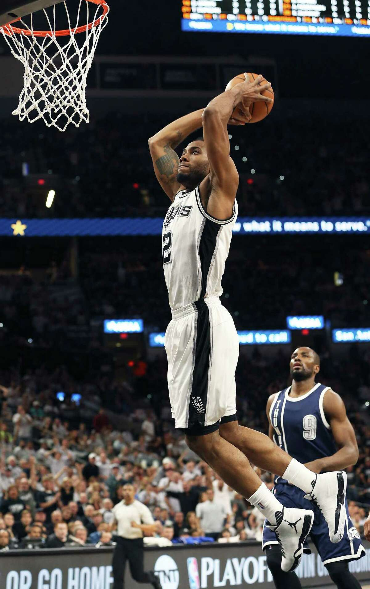 Kawhi Leonard goes up for a two handed slam on a break away as the Spurs host the Thunder in game 1 of second round NBA playoff action at the AT&T Center on April 230, 2016.