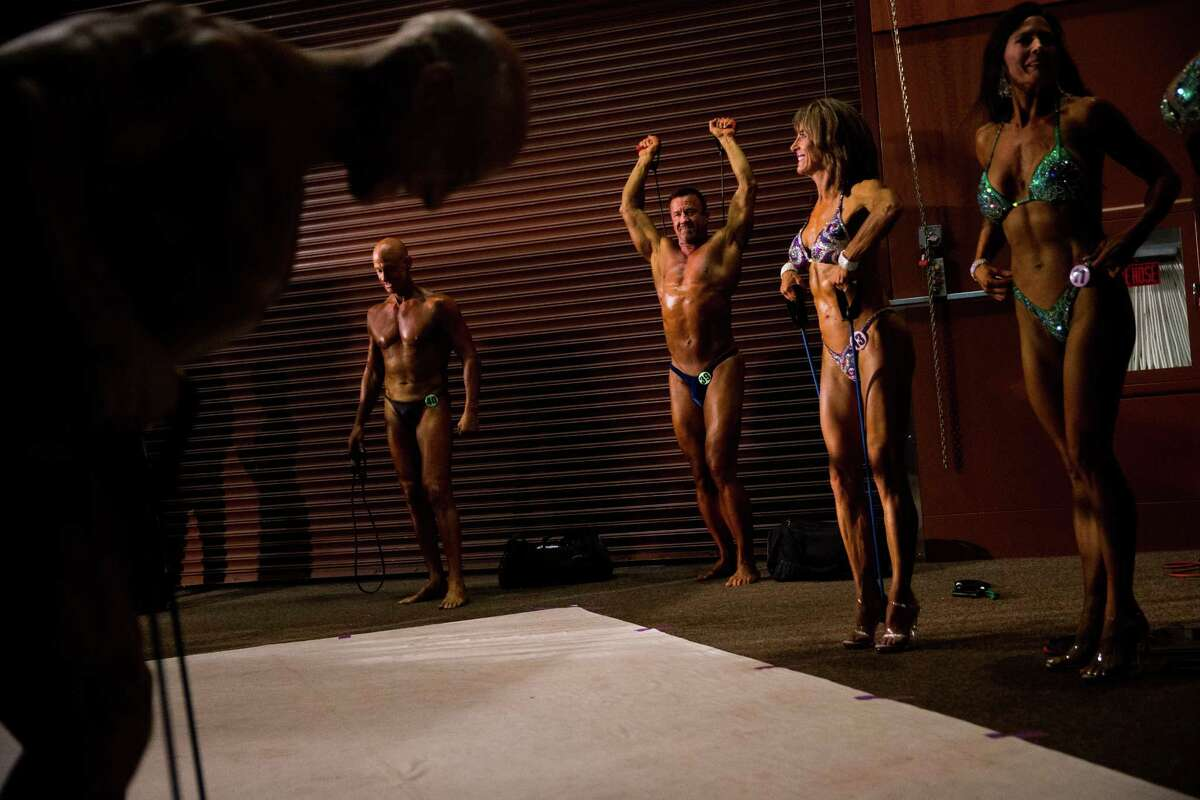 Will Fieser pumps up backstage with numerous other bodybuilders at the 2016 Emerald Cup at the Meydenbaur Center in Bellevue on Friday, April 29, 2016.