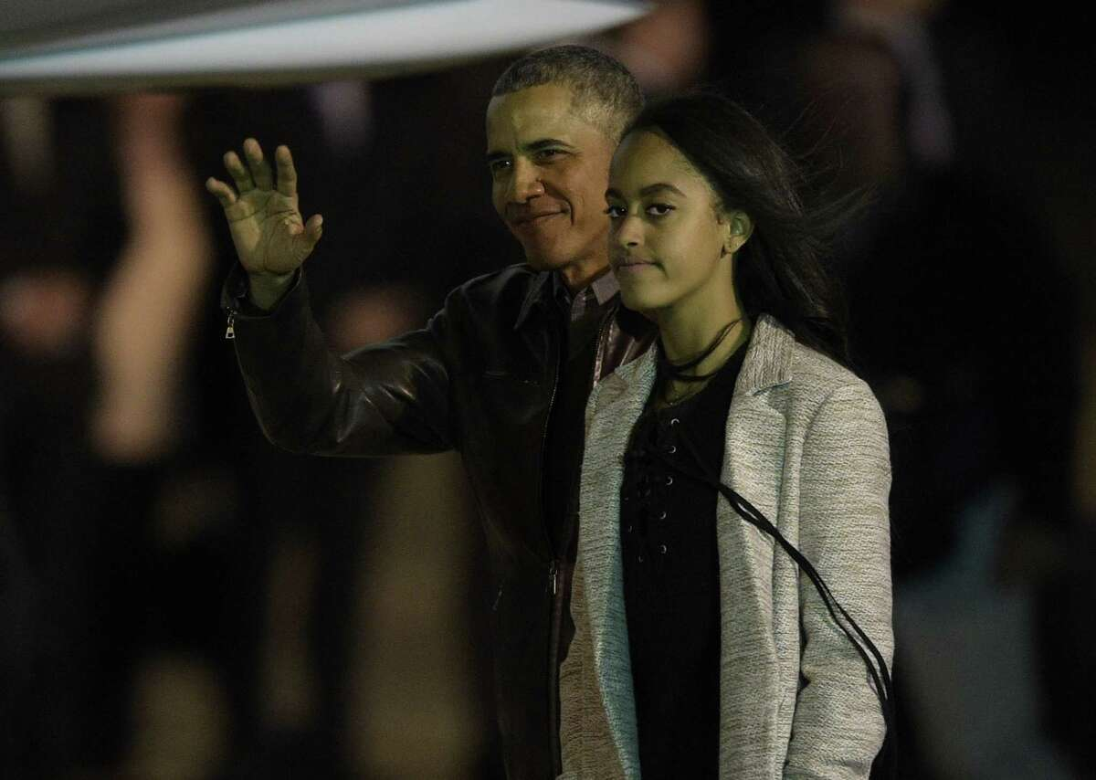 US President Barack Obama waves next to his daughter Malia before boarding the Air Force One at Ministro Pistarini International Airport in Ezezia, Buenos Aires, Argentina on March 24, 2016. / AFP PHOTO / JUAN MABROMATAJUAN MABROMATA/AFP/Getty Images