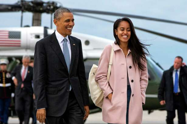 FILE - In a Thursday, April 7, 2016 file photo, President Barack Obama jokes with his daughter Malia Obama as they walk to board Air Force One from the Marine One helicopter, as they leave Chicago en route to Los Angeles.  The White House announced Sunday, May 1, 2016, that Malia Obama will take a year off after high school and attend Harvard University in 2017. (AP Photo/Jacquelyn Martin, File) ORG XMIT: NY110