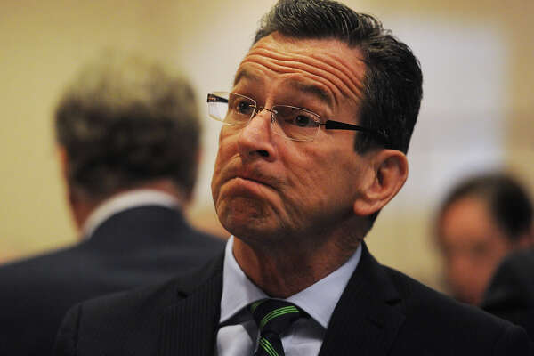 Governor Dannel P. Malloy listens as he is introduced to speak at the Bridgeport Regional Business Council's 2016 Capitol Luncheon at the Holiday Inn in Bridgeport, Conn. on Wednesday, April 27, 2016.