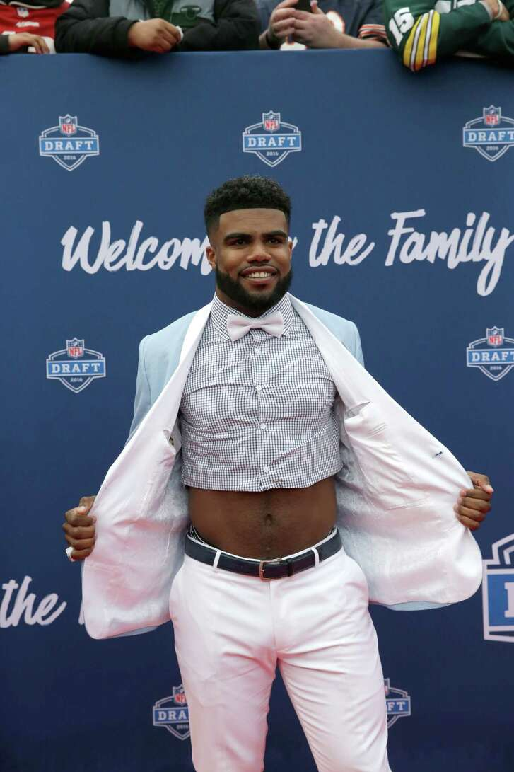 Ohio State's Ezekiel Elliott poses for photos upon arriving for the first round of the 2016 NFL football draft at the Auditorium Theater of Roosevelt University, Thursday, April 28, 2016, in Chicago. (AP Photo/Nam Y. Huh)