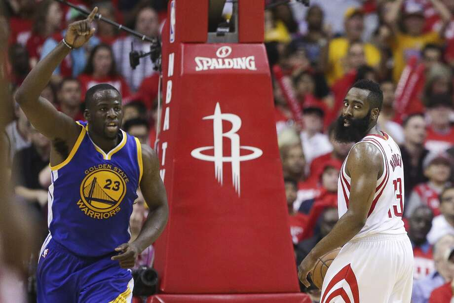 Golden State Warriors forward Draymond Green (23) celebrates after making a shot as Houston Rockets guard James Harden (13) looks back to inbound the ball during the second half in game four of a first-round NBA Playoffs series at Toyota Center Sunday, April 24, 2016 in Houston. ( Michael Ciaglo / Houston Chronicle ) Photo: Michael Ciaglo, Houston Chronicle