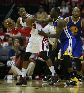 Houston Rockets center Dwight Howard (12) works against Golden State Warriors forward Draymond Green (23) during the second half of game four of the first round of the NBA playoff series at Toyota Center, Sunday, April 24, 2016, in Houston. ( Karen Warren  / Houston Chronicle )