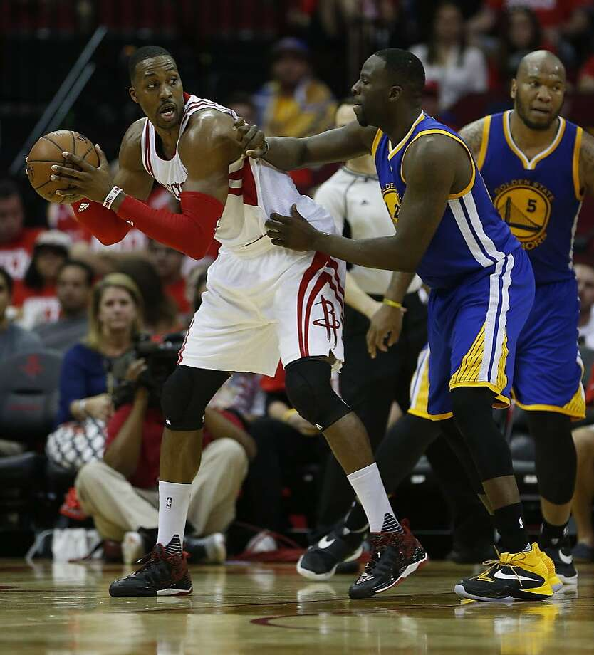 Houston Rockets center Dwight Howard (12) works against Golden State Warriors forward Draymond Green (23) during the second half of game four of the first round of the NBA playoff series at Toyota Center, Sunday, April 24, 2016, in Houston. ( Karen Warren  / Houston Chronicle ) Photo: Karen Warren, Houston Chronicle