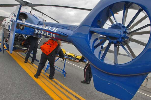 Paramedics load a patient into a LifeNet helicopter near the Tomhannock Reservoir on April 1, 2008, in Pittstown, N.Y.  LifeNet, which provides service within the Capital Region, is a subsidiary of Air Methods. (Lori Van Buren/Times Union archive)