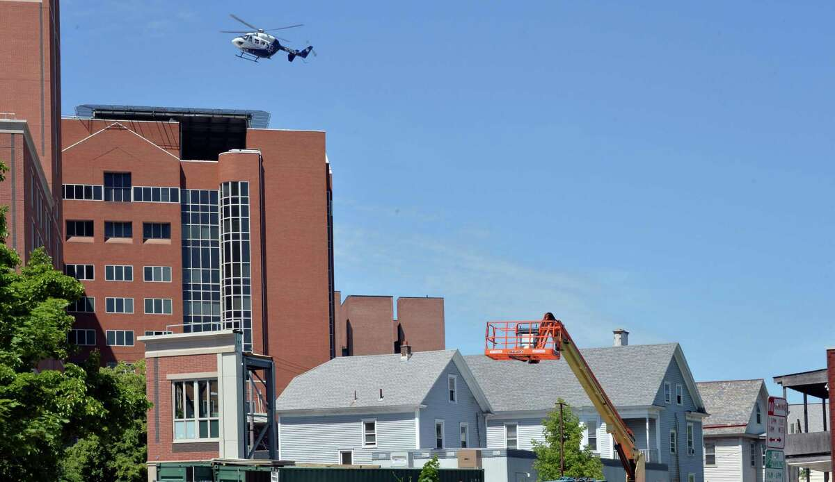 A LifeNet medivac helicopter flies over Myrtle Avenue to land atop Albany Medical Center on New Scotland Avenue in the city's Park South neighborhood in Albany, NY, Wednesday June 5, 2013. (John Carl D'Annibale / Times Union archive)