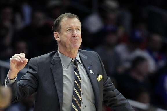 Portland Trail Blazers head coach Terry Stotts reacts to a referee's call during the first half of an NBA basketball game against the Los Angeles Clippers in Los Angeles, Thursday, March 24, 2016. (AP Photo/Alex Gallardo)