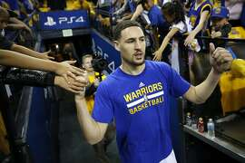 Golden State Warriors' Klay Thompson heads to the court to warm up before playing the Portland Trail Blazers in Game 1 of NBA Playoffs' Western Conference Semifinals at Oracle Arena in Oakland, Calif., on Sunday, May 1, 2016.