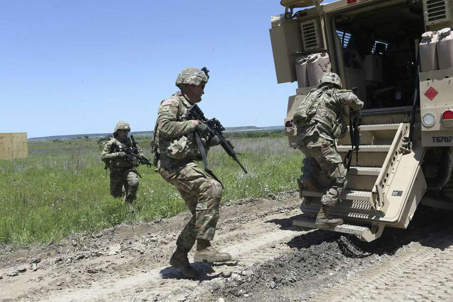 Soldiers from the U.S. Army 3rd Cavalry enter a Mine-Resistant Ambush Protected vehicle, (MRAP), while training at Fort Hood, Wednesday, April 27, 2016. About 1,000 troops with the 3rd Cavalry based at Fort Hood will deploy to Afghanistan later this spring in support of the U.S. mission to train, advise and assist Afghan security forces. The unit is conducting its final weeks of training in preparation for heading overseas at a time when the Taliban is regaining ground and ISIS is emerging as a threat in the country's eastern region. Photo: JERRY LARA, Staff / San Antonio Express-News / © 2016 San Antonio Express-News