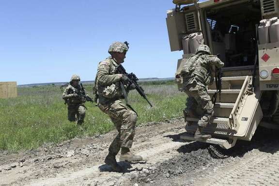 Soldiers from the U.S. Army 3rd Cavalry enter a Mine-Resistant Ambush Protected vehicle, (MRAP), while training at Fort Hood, Wednesday, April 27, 2016. About 1,000 troops with the 3rd Cavalry based at Fort Hood will deploy to Afghanistan later this spring in support of the U.S. mission to train, advise and assist Afghan security forces. The unit is conducting its final weeks of training in preparation for heading overseas at a time when the Taliban is regaining ground and ISIS is emerging as a threat in the country's eastern region.
