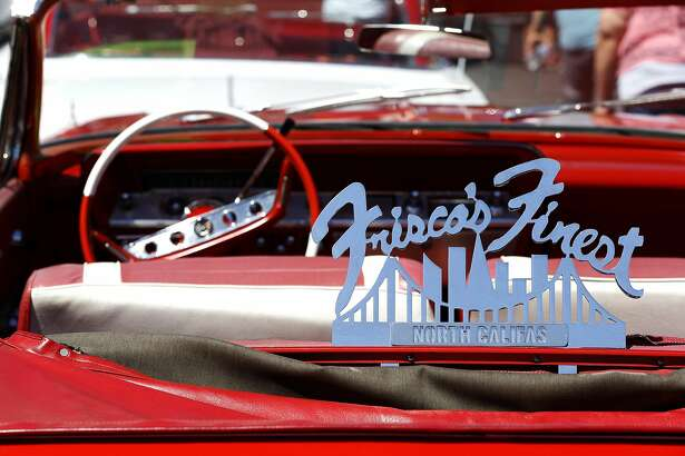 A sign for Frisco's Finest on the back of a convertible during the Give Something Back Car Show at John O'Connell High School in San Francisco, California, on Sunday, May 1, 2016.