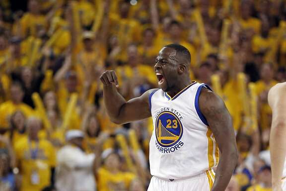 Golden State Warriors' Draymond Green celebrates his 1st quarter basket against Portland Trail Blazers during Game 1 of NBA Playoffs' Western Conference Semifinals at Oracle Arena in Oakland, Calif., on Sunday, May 1, 2016.