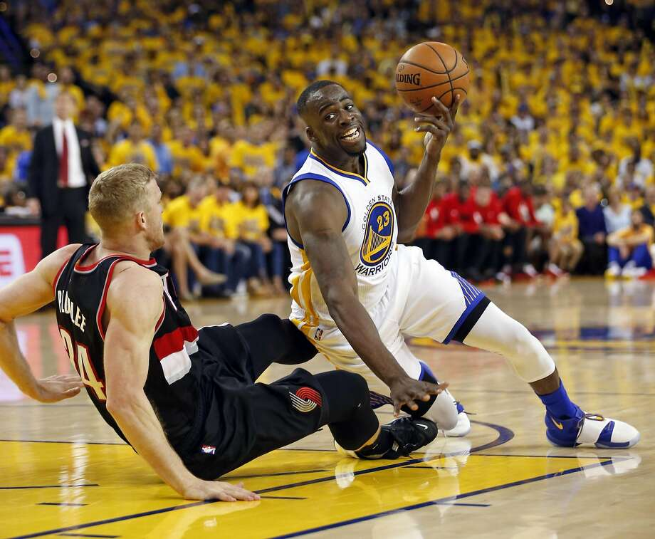 Warriors forward Draymond Green is fouled by the Trail Blazers' Mason Plumlee in 2nd quarter during Game 1 of NBA Playoffs' Western Conference Semifinals at Oracle Arena in Oakland, Calif., on Sunday, May 1, 2016. Photo: Scott Strazzante, The Chronicle