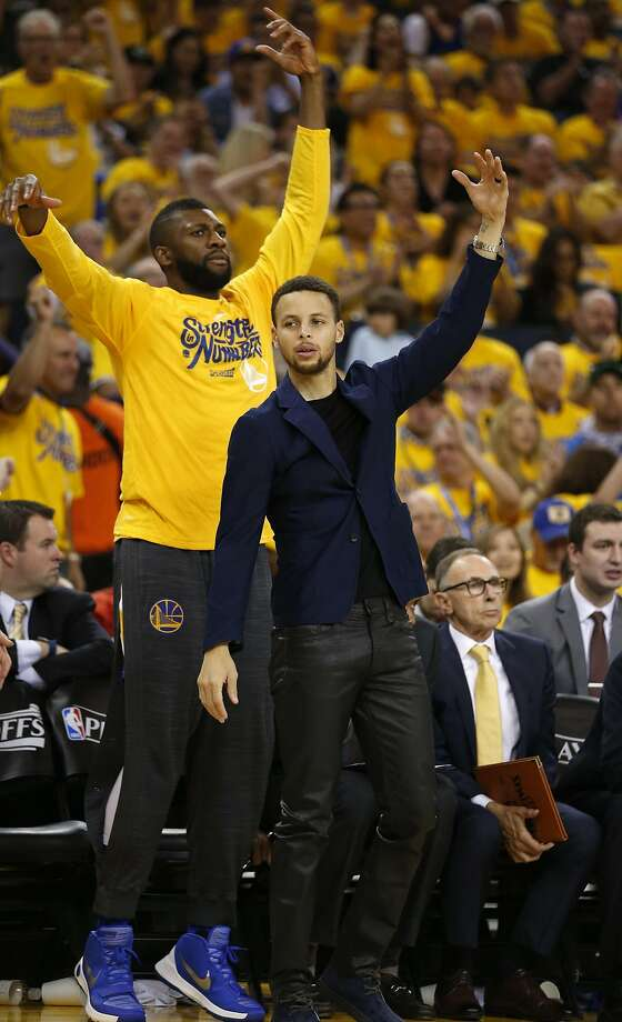 Golden State Warriors' Stephen Curry and Festus Ezeli react to Warriors' 3-pointer in n2d quarter against Portland Trail Blazers during Game 1 of NBA Playoffs' Western Conference Semifinals at Oracle Arena in Oakland, Calif., on Sunday, May 1, 2016. Photo: Scott Strazzante, The Chronicle