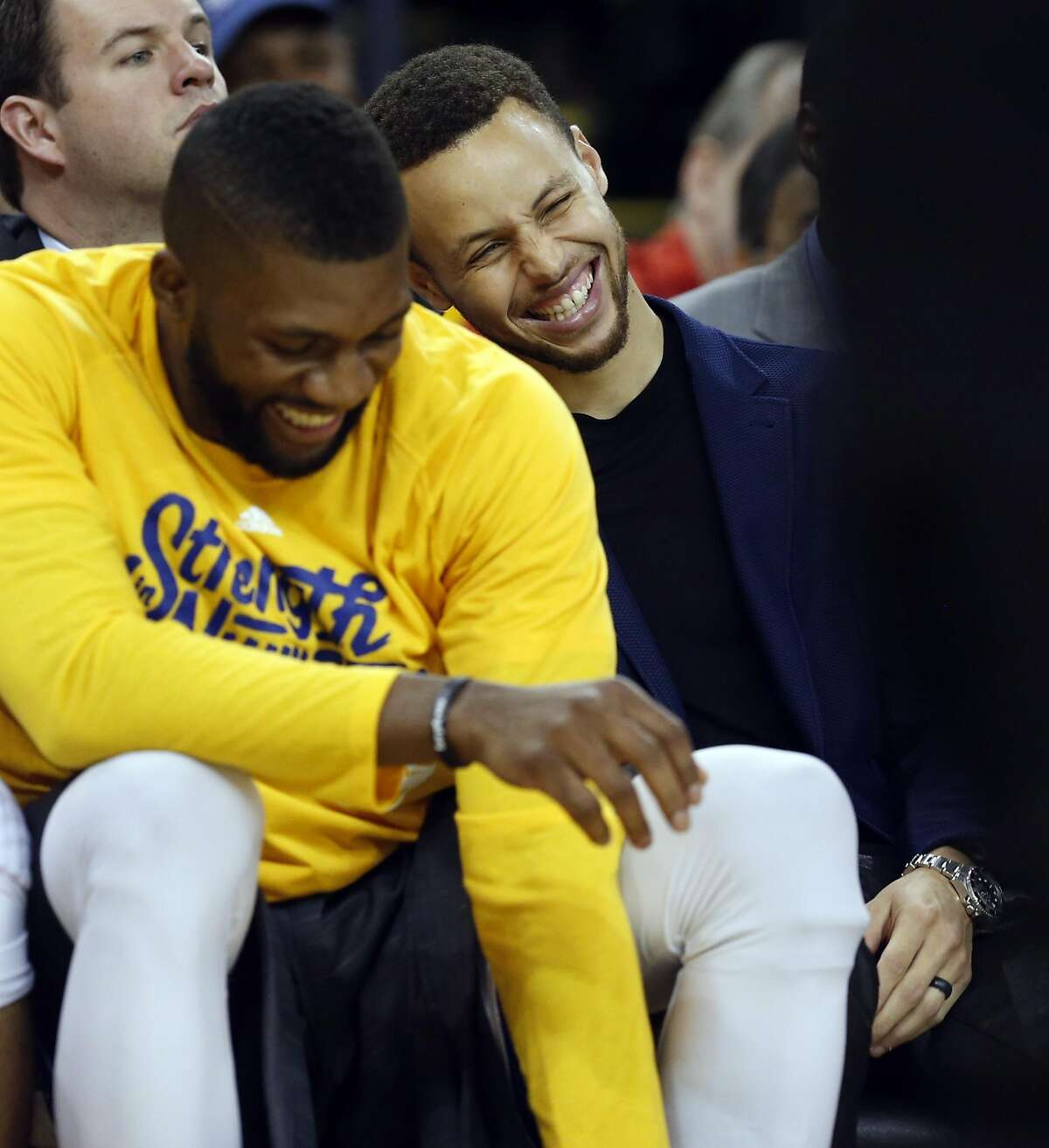 Golden State Warriors' Stephen Curry and Festus Ezeli enjoy themselves in 2nd quarter against Portland Trail Blazers during Game 1 of NBA Playoffs' Western Conference Semifinals at Oracle Arena in Oakland, Calif., on Sunday, May 1, 2016.