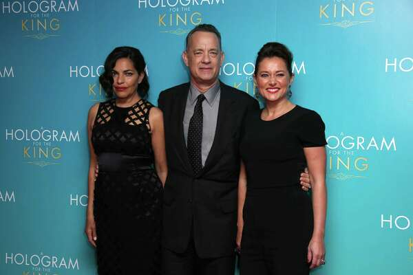 Actors Sarita Choudhury, from left, Tom Hanks and Sidse Babett Knudsen pose for photographers upon arrival at the premiere of the film 'A Hologram For The King' in London, Monday, April 25, 2016. (Photo by Joel Ryan/Invision/AP) ORG XMIT: LENT109