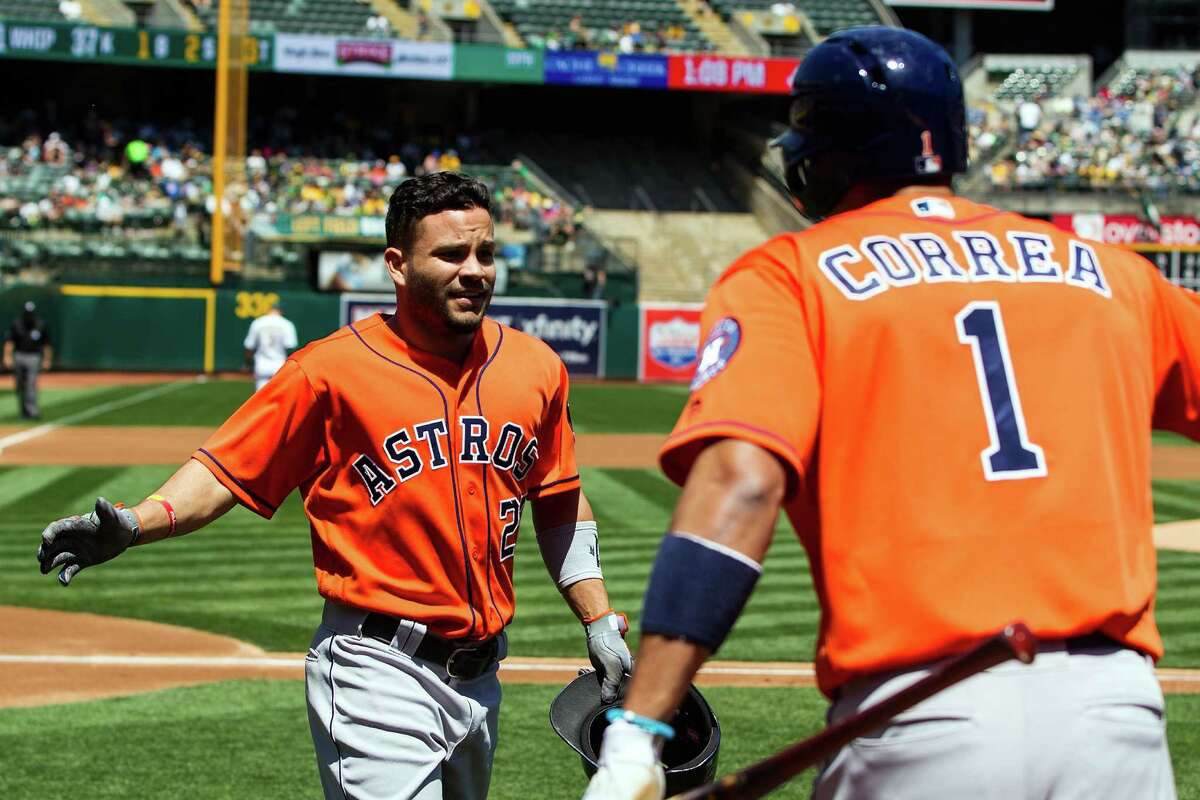 May 1: Astros 2, Athletics 1 OAKLAND, CA - MAY 01: Jose Altuve #27 of the Houston Astros is congratulated by Carlos Correa #1 after hitting a home run against the Oakland Athletics during the first inning at the Oakland Coliseum on May 1, 2016 in Oakland, California.