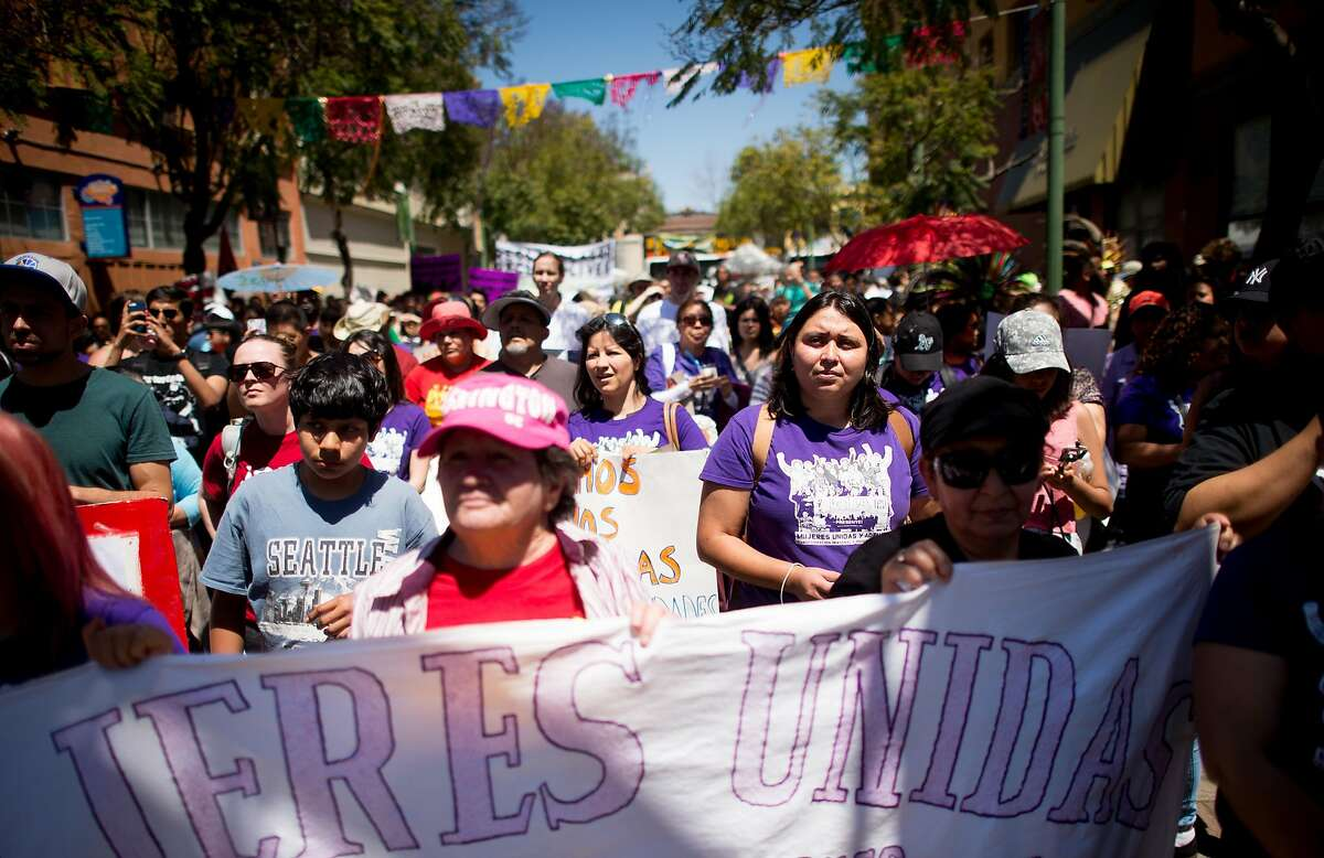 Protesters calling for increased worker rights gather near the Fruitvale BART station during a May Day rally in Oakland, Calif., on Sunday, May 1, 2016.