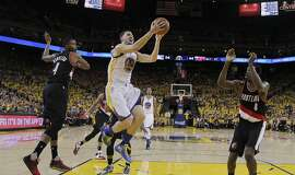 Golden State Warriors' Klay Thompson (11) drives past Portland Trail Blazers' Maurice Harkless (4) and Al-Farouq Aminu (8) during the first half in Game 1 of a second-round NBA basketball playoff series Sunday, May 1, 2016, in Oakland, Calif. (AP Photo/Marcio Jose Sanchez)